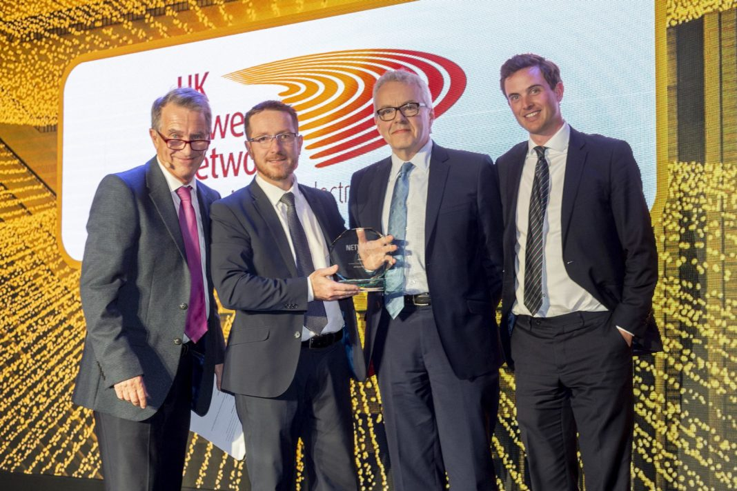 (L-R) Garry Richardson, BBC broadcaster and host of the Networks Awards, Ian Cameron, head of innovation UK Power Networks, Eric Brown, Director of Innovation, The Energy Systems Catapult and category judge, Alex Jakeman, innovation project lead, UK Power Networks at the Network Awards.